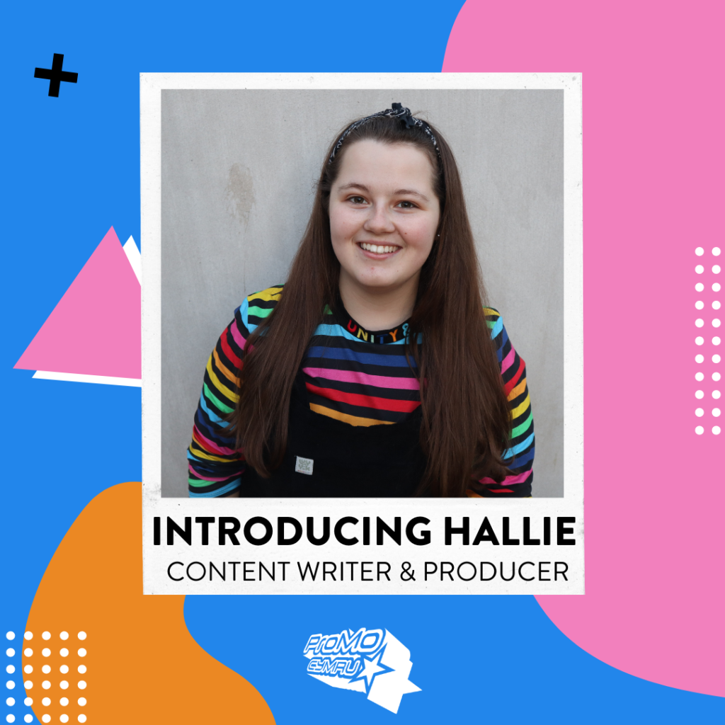 Image of Hallie new content writer and producer on the Kickstart scheme. Long brown hair, smiling face, rainbow striped jumper.